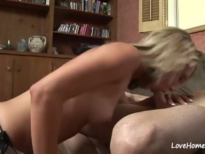 Light-haired gf on her knees stroking his penis