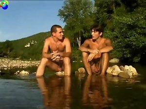 Naturist studs walk thru the stream and then talk