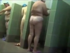 Aged housewives showering after swimming