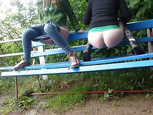 Two tempting 18 years friends piss together in a park