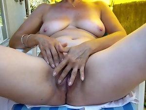 My whore flashing and masturbating outdoors