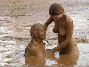 Sexual lesbos in muddy restrain bondage
