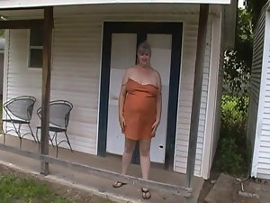 Kim Bates unclothing outside. What an ass.
