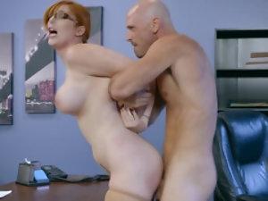 Redhead secretary has her big tits worshiped