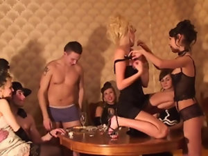 Teen jumps on the table and starts stripping to rock the party