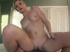 Blonde gal is in her favorite sex position called reversed cowgirl