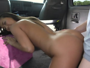 Asian hottie relaxes in backseat with one lucky stranger