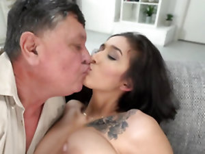Chick with natural tits copulates on couch with old man