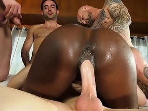 There are four white cocks and black slut rides them in turn
