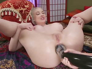 Dominant woman takes care of submissive chick's asshole on floor