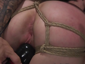 Bald master fucks tied up submissive blonde with tattooed body