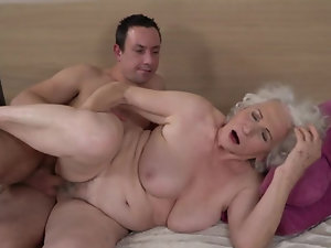 Grey-haired female gets her hairy cunt fucked by younger boy