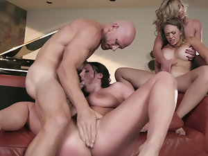 Three milfs have a wild time fucking his big cock