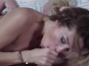 A big ass bimbo is on the bed on the white sheets, getting fucekd