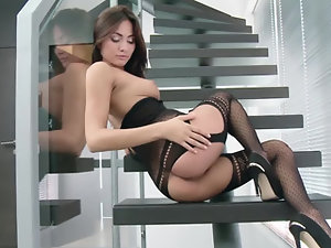 A bimbo brunette opens up her pussy and she shows off solo