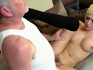 A blonde with tattoos and short hair is getting fucked in her pussy