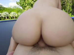 A bimbo with a big round ass is fucked on the trampoline outdoors