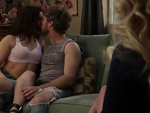 A girl is getting penetrated by a dude on the sofa in front of his wife