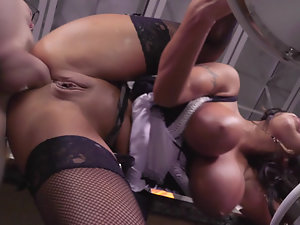 A bimbo with some fine large tits is on the table, getting fucked