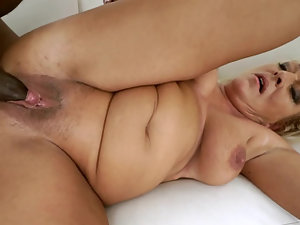 A fat old granny receives an old black pecker inside her