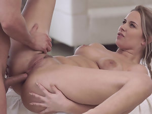 During massage, beautiful babe is nicely fucked in tight asshole