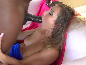 A blonde is with her black lover, getting her tight ass fucked
