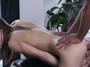 A brunette with long hair is penetrated in her ass in front of the camera