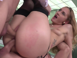 Hot bimbo is handling two big dicks at once in the kinky video