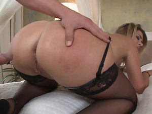 A pretty lady gets her tight ass stretched a bit wider