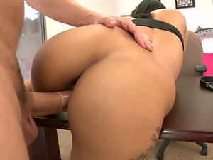 Latina bent over a desk with a big dick fucking her pussy