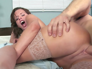 A hot bitch is getting her pussy loved by a really large cock