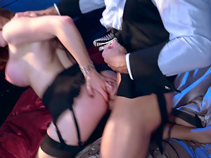 A redhead is getting her large tits and cunt fucked at a party
