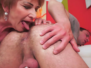 A fat old woman that loves to lick young dick is getting rammed