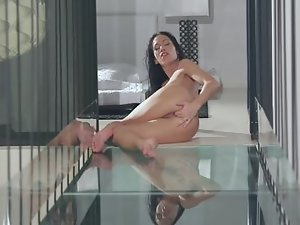 A solo girl is sticking her hand in her wet and sexy pussy